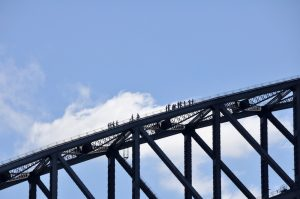 Head for heights, walkers near the top of Stydney Harbor Bridge.